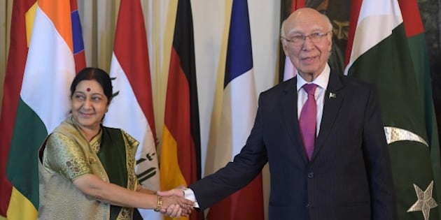 Pakistan's National Security Advisor Sartaj Aziz (R) shakes hands with Indian Foreign Minister Sushma Swaraj at The Foreign Ministry in Islamabad on December 9, 2015, ahead of talks. Afghan president Ashraf Ghani arrived in Islamabad hoping to revive peace talks with the resurgent Taliban, as he opened a regional conference that has taken on added significance with the attendance of India's top diplomat. AFP PHOTO / Aamir QURESHI / AFP / AAMIR QURESHI        (Photo credit should read AAMIR QURESHI/AFP/Getty Images)