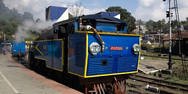 The Nilgiri Queen meter gauge cog-drive steam locomotive has pulled us from Mettupalayam to Conoor along the Nilgiri Mountain Railway.  Here, in the Conoor station, she has been detached to be replaced by a diesel locomotive for the final leg up to Ooty.