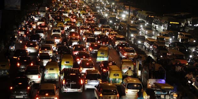 NEW DELHI, INDIA - NOVEMBER 17: Traffic Jam near ITO during the Chhath festival, on November 17, 2015 in New Delhi, India. Chhath festival, also known as Surya Pooja (worship of the sun), is observed in eastern parts of India where homage is paid to the sun and water Gods eight days after Diwali, the festival of lights. During Chhath festival, devotees undergo a fast and offer water and milk to the Sun God at dawn and dusk. The Goddess who is worshipped during the famous Chhath Puja is known as Chhathi Maiya. Chhathi Maiya is known as [goddess] in the Vedas. She is believed to be the beloved younger sister of Surya, the sun god. Some scholars believed that she is the only sister of sun god. The Chhath Puja is performed in order to thank Surya for sustaining life on earth and to request the granting of certain wishes. This festival is observed by people living in Nepal and India (mainly in the State of Bihar and Uttar Pradesh. (Photo by Sonu Mehta/Hindustan Times via Getty Images)