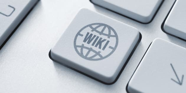 Computer button on a keyboard with wiki encyclopedia icon symbol