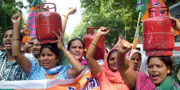 NEW DELHI, INDIA - OCTOBER 12: BJP Mahila Morcha activists carry LPG cylinders during a protest against the recent hike in prices of cooking gas, electricity and diesel at Jantar Mantar in New Delhi on Friday. (Photo by Ramesh Sharma/India Today Group/Getty Images)