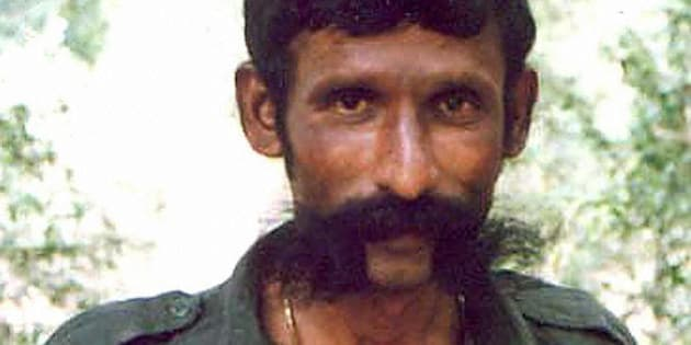 -, INDIA:  (FILES) An undated file photo shows India's most wanted man, Koose Muniswamy Veerappan. India's most wanted criminal, Veerappan, who was accused of more than 100 murders, has been shot dead after decades on the run, police said 19 October 2004. The bandit, said to be around 60 years old now, was killed in a forest in southeastern Tamil Nadu state, said Special Task Force chief K. Vijay Kumar.   AFP PHOTO  (Photo credit should read -/AFP/Getty Images)