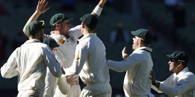 Australian players celebrate after the final wicket of West Indies' Jerome Taylor during their cricket test match in Melbourne, Australia, Tuesday, Dec. 29, 2015. (AP Photo/Andy Brownbill)
