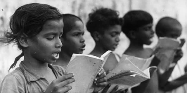 A group of Indian children singing in a central school which serves several villages around Mudichuri, Madras.