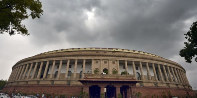 NEW DELHI, INDIA - JULY 30: Dense clouds over the Parliament House during the ongoing Monsoon Session on July 30, 2015 in New Delhi, India. The Lok Sabha was adjourned for the day as a mark of respect to former President APJ Abdul Kalam, while the Rajya Sabha was adjourned till 2 pm. (Photo by Sonu Mehta/Hindustan Times via Getty Images)