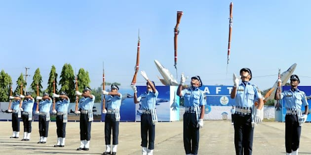 The Air Warrior Drill Team of the Indian Air Force perform a routine during a passing out parade of Aeronautical Engineers at The Air Force Technical College in Bangalore on December 4, 2015.   The Parade marks the culmination of 74 weeks of training in Aeronautical Engineering, Military Leadership, Managerial Skills and Ethos of an air warrior. The passing out batch comprised 136 officers, including 37 women and 11 international officers. AFP PHOTO/Manjunath KIRAN / AFP / MANJUNATH KIRAN        (Photo credit should read MANJUNATH KIRAN/AFP/Getty Images)