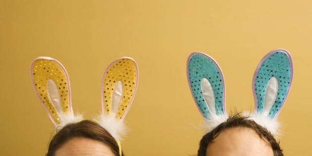 Caucasian mid adult couple wearing rabbit ears.