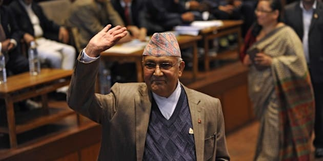 Nepal's Prime Minister KP Sharma Oli waves after casting his vote in an election for Nepal's new president in Kathmandu on October 28, 2015.  The legislature was to vote on October 28 for a replacement for Ram Baran Yadav as ceremonial head of state, as required under the new constitution adopted last month.       AFP PHOTO / Prakash MATHEMA        (Photo credit should read PRAKASH MATHEMA/AFP/Getty Images)