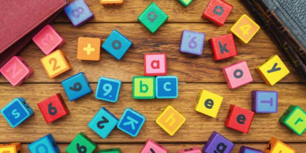 Alphabet blocks on the school desk