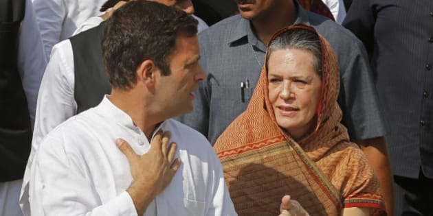 India's ruling Congress party President Sonia Gandhi, right, speaks with her son and party Vice President Rahul Gandhi after the latter filed his nomination for the ongoing general elections in Amethi, in the northern Indian state of Uttar Pradesh, Saturday, April 12, 2014. Gandhi, heir to the country's Nehru-Gandhi political dynasty, is leading the struggling party's campaign in the general election. The multiphase voting across the country runs until May 12, with results for the 543-seat lower house of parliament announced May 16. (AP Photo/ Rajesh Kumar Singh)