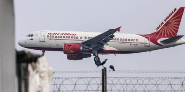 An Airbus SAS A319 aircraft operated by Air India Ltd. approaches to land at Chhatrapati Shivaji International Airport in Mumbai, India, on Monday, Oct. 26, 2015. Air India is the nation's third biggest airline by market share. Photographer: Dhiraj Singh/Bloomberg via Getty Images