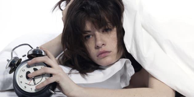 woman in bed awakening
