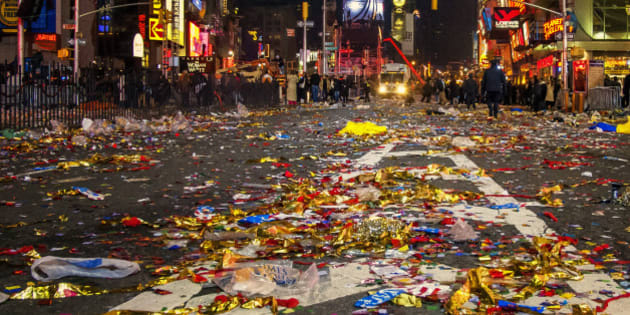 New Years Eve in Times Square in Manhattan, New York, lots of people in the background, after the party lots of garbage in the floor the celebration is over, people going to their homes.