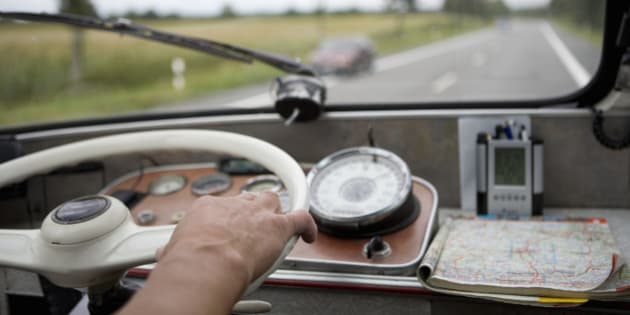 Close up of hand on steering wheel