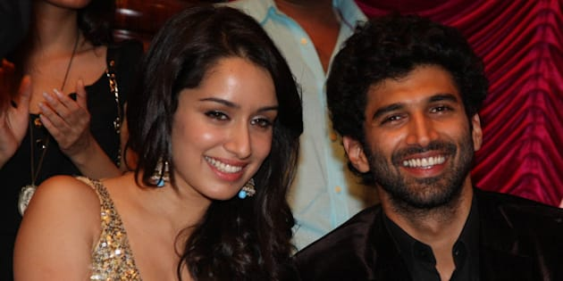 Indian Bollywood actors Shraddha Kapoor (L) and Aditya Roy Kapoor attend a soundtrack launch event for the forthcoming Hindi Film 'Aashiqui 2'  in Mumbai on April 8, 2013. AFP PHOTO        (Photo credit should read STRDEL/AFP/Getty Images)