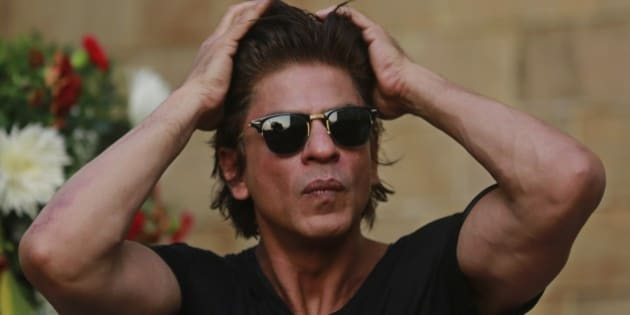 Bollywood superstar Shahrukh Khan adjusts his hair as he listens to a question from a journalist  on his birthday in Mumbai, India, Sunday, Nov. 2, 2014. (AP Photo/Rafiq Maqbool)