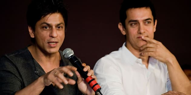 BOMBAY, INDIA - APRIL 07:  Bollywood superstars Shah Rukh Khan and Aamir Khan takes part in discussions about how to resolve the current impasse between multiplexes and film producers over sharing equal revenue in Bollywood at J. W. Marriott on April 7, 2009 in Bombay, India  (Photo by Ritam Banerjee/Getty Images)
