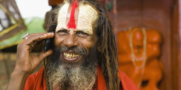 Sadhu man with mobile phone