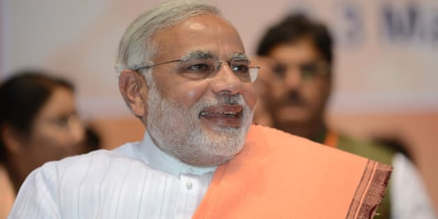 Indian Chief Minister of Gujarat, Narendra Modi, laughs during a BJP National Council two day meeting in New Delhi on March 2, 2013.  Amid calls for a larger role for him Modi won singular praise from BJP President Rajnath Singh for being the 'most popular' chief minister having registered 'never before' three consecutive electoral wins for the party in Gujarat.  In a poll published in January, 36 percent of voters surveyed said Modi would make the best prime minister -- well ahead of his likely election rival Rahul Gandhi of the ruling Congress party who had just 22 percent.  AFP PHOTO/ RAVEENDRAN        (Photo credit should read RAVEENDRAN/AFP/Getty Images)