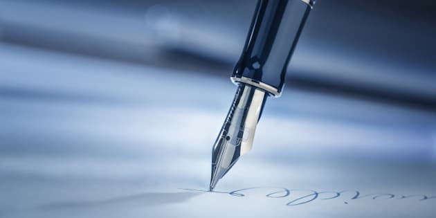 Signing a legal document with a fountain pen.