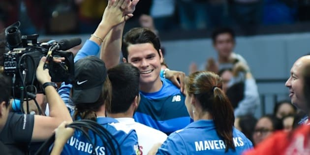 MANILA, PHILIPPINES - DECEMBER 08: Canadian player Milos Raonic celebrates victory against Spains Rafael Nadal of the Indian Aces after the mens singles match for the International Premiere Tennis League (IPTL) at the Mall of Asia Arena in Pasay City, south of Manila, Philippines on December 08, 2015. (Photo by George Calvelo/Anadolu Agency/Getty Images)