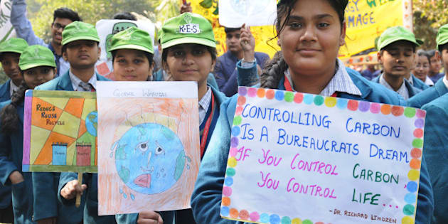 NEW DELHI, INDIA - DECEMBER 30: School children took out a rally in support of the odd-even formula introduced by the Delhi Government for controlling pollution on December 30, 2015 in Janakpuri in New Delhi, India. The odd-even formula will be enforced from January 1, 2016 for a trial period of 15 days. (Photo by S Burmaula/Hindustan Times via Getty Images)