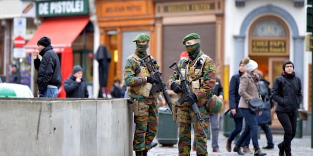 BRUSSELS, BELGIUM - DECEMBER 29: Security forces of Belgium stand guard as two people arrested on suspicion of terrorism in Brussels, Belgium on December 29, 2015. (Photo by Dursun Aydemir/Anadolu Agency/Getty Images)