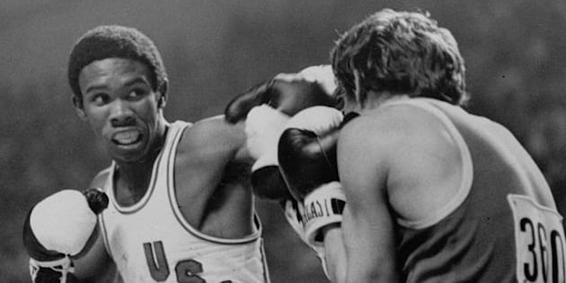 U.S.A. boxer Howard Davis slugs it out with Yugoslavian Ace Rusevski in lightweight boxing action at the Montreal Olympics Thursday, July 29, 1976.  Davis was the winner. (AP Photo/pool)