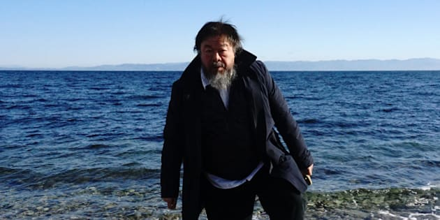 Chinese activist and artist Ai Weiwei walks on a beach near the town of Mytilene, on the Greek island of Lesbos on January 1, 2016. Chinese dissident artist Ai Weiwei paid on December 28, 2015 a holiday visit to refugees and migrants flocking to the Greek island of Lesbos, tweeting out photos and videos in appeals for their plight. / AFP / ANGELOS TZORTZINIS        (Photo credit should read ANGELOS TZORTZINIS/AFP/Getty Images)