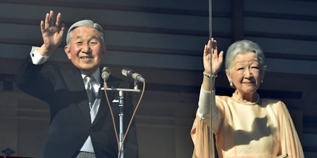 Japanese Emperor Akihito (L) and Empress Michiko wave to well-wishers gathered for the annual New Year's greetings at the Imperial Palace in Tokyo on January 2, 2016.  Akihito called for peace in his New Year's greeting to more than 62,000 visitors.   AFP PHOTO / KAZUHIRO NOGI / AFP / KAZUHIRO NOGI        (Photo credit should read KAZUHIRO NOGI/AFP/Getty Images)
