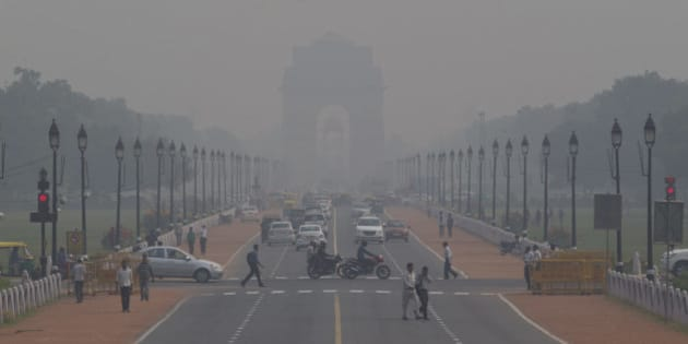 India Gate, one of the landmarks of central Delhi, is barely visible through thick smog in New Delhi, India, Monday, Nov. 9, 2015.  Delhi's air quality has been hitting new lows over the past week and authorities are urging people to refrain from lighting smoke emanating firecrackers during the upcoming Diwali festival. (AP Photo/Saurabh Das)