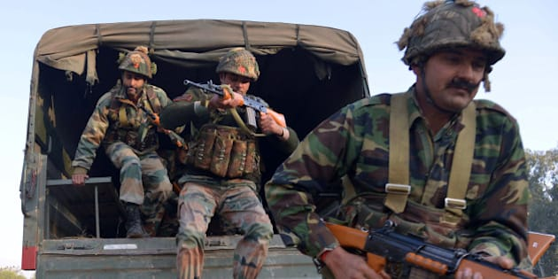 Indian army personnel leap from the rear of a truck at an airforce base in Pathankot on January 3, 2016, during an operation to 'sanitise' the base following an attack by gunmen.  The deadly assault on an Indian air base near the Pakistan border was 'a heinous' terrorist attack, the United States said, urging the two rivals to work together to hunt down those responsible. Three security officers were killed in the attack by suspected Islamist militants on Pathankot base in northern Punjab state early January 2. At least four attackers also died in shootouts with security forces.   AFP PHOTO/NARINDER NANU / AFP / NARINDER NANU        (Photo credit should read NARINDER NANU/AFP/Getty Images)