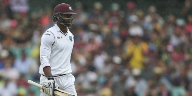 West Indies batsman Marlon Samuels walks off the field after he was run out during their cricket test match against Australia in Sydney Sunday, Jan. 3, 2016.(AP Photo/Rob Griffith)
