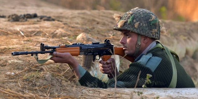 An Indian army soldier takes up position on the perimeter of an airforce base in Pathankot on January 3, 2016, during an operation to 'sanitise' the base following an attack by gunmen. The deadly assault on an Indian air base near the Pakistan border was 'a heinous' terrorist attack, the United States said, urging the two rivals to work together to hunt down those responsible. Three security officers were killed in the attack by suspected Islamist militants on Pathankot base in northern Punjab state early January 2. At least four attackers also died in shootouts with security forces. AFP PHOTO/NARINDER NANU / AFP / NARINDER NANU        (Photo credit should read NARINDER NANU/AFP/Getty Images)