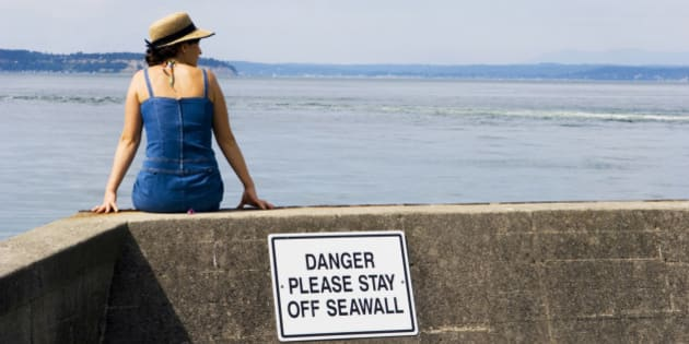 Lady is oblivious - rules just don't apply to some people.  Just sitting by the bay.