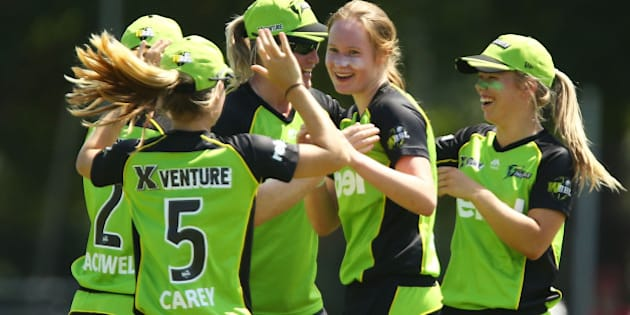 SYDNEY, AUSTRALIA - DECEMBER 06:  Lauren Cheatle of the Thunder celebrates with team mates after taking the wicket of Sara McGlashan of the Sixers during the Women's Big Bash League match between the Sydney Thunder and the Sydney Sixers at Howell Oval on December 6, 2015 in Sydney, Australia.  (Photo by Matt King - CA/Cricket Australia/Getty Images)
