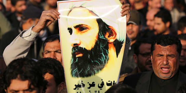 An Iraqi man holds a portrait of prominent Shiite Muslim cleric Nimr al-Nimr during a demonstration against his execution by Saudi authorities, on January 3, 2016, in the capital Baghdad. Iran and Iraq's top Shiite leaders condemned Saudi Arabia's execution of Nimr, warning ahead of protests that the killing was an injustice that could have serious consequences. AFP PHOTO / AHMAD AL-RUBAYE / AFP / AHMAD AL-RUBAYE        (Photo credit should read AHMAD AL-RUBAYE/AFP/Getty Images)