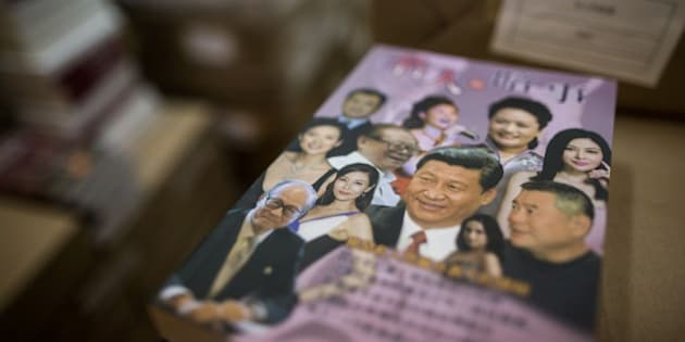 A book with Chinese President Xi Jinping (C on book) is displayed at the warehouse of Hong Kong-based publisher Mighty Current in Hong Kong on January 2, 2016. A missing Hong Kong employee from a publisher of books critical of China was 'assisting in an investigation', his wife said on January 2, as the city's deputy leader sought to reassure residents over their safety. AFP PHOTO / ANTHONY WALLACE / AFP / ANTHONY WALLACE        (Photo credit should read ANTHONY WALLACE/AFP/Getty Images)