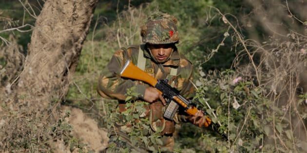 An Indian army soldier is seen during a search operation in a forest area outside the Pathankot air force base in Pathankot, India, Sunday, Jan. 3, 2016. Combing operations to secure the Indian air force base where a group of militants started an attack before dawn on Saturday were continuing late Sunday morning. (AP Photo/Channi Anand)