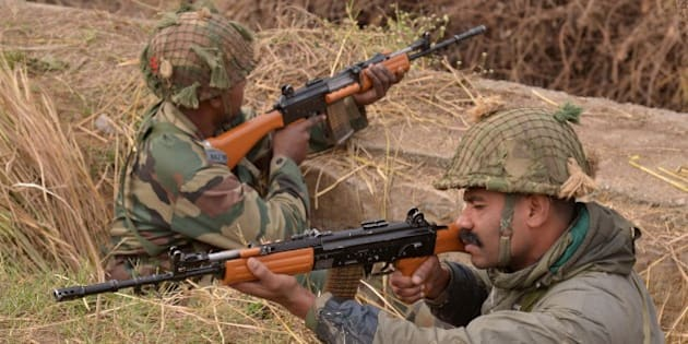 Indian army soldiers take up position on the perimeter of an airforce base in Pathankot on January 4, 2016. Indian troops backed by helicopters searched an air force base in the northern state of Punjab, after a weekend of fierce fighting with suspected Islamic insurgents in which seven soldiers and at least four attackers were killed. AFP PHOTO/ NARINDER NANU / AFP / NARINDER NANU        (Photo credit should read NARINDER NANU/AFP/Getty Images)