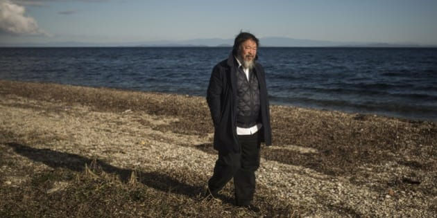Chinese activist and artist Ai Weiwei walks on a beach next to the town of Mytilini, on the Greek island of Lesbos, Friday, Jan. 1, 2016. The Chinese artist visited the island of Lesbos in solidarity with refugees and migrants who continue to arrive on a daily basis hoping to make their way into Europe.   (AP Photo/Santi Palacios)