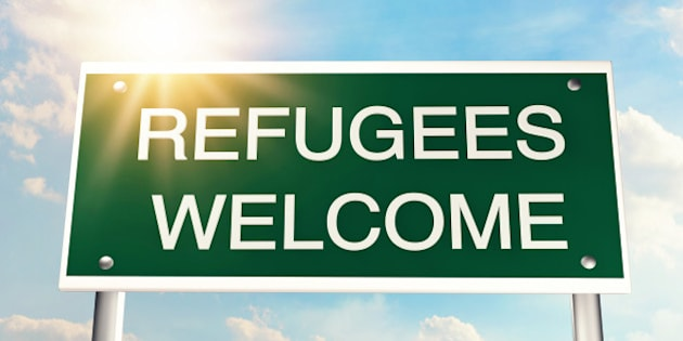 Refugees welcome as a road sign