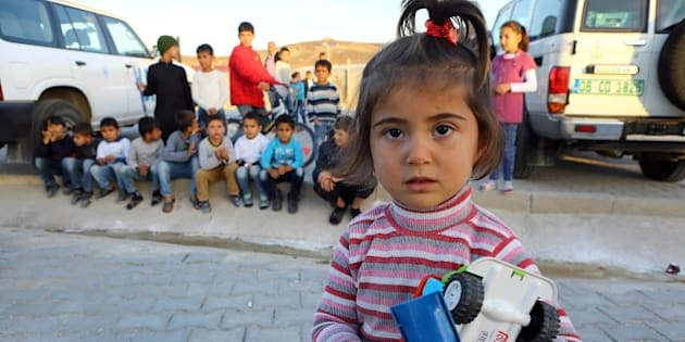 Syrian Refugee children are pictured at the refugee camp in Osmaniye on December 15, 2015. Turkey is home to at least 2.2 million Syrian refugees after President Recep Tayyip Erdogan declared an open door policy at the onset of the Syrian crisis. Out of the 2.2 million Syrians in Turkey, only around 260,000 stay in camps near the Syrian border and the remaining vast majority is scattered throughout the country including big cities like Istanbul. Education is one of the main challenges.  / AFP / ADEM ALTAN / TO GO WITH AFP STORY BY FULYA OZERKAN        (Photo credit should read ADEM ALTAN/AFP/Getty Images)