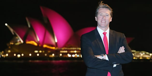 SYDNEY, AUSTRALIA - SEPTEMBER 16:  Glen McGrath stands in front of the Sydney Opera House, with its sails turned pink to commemorate ten years of placing McGrath Breast Care Nurses in communities across Australia, on September 16, 2015 in Sydney, Australia.  (Photo by Don Arnold/WireImage)