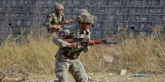Indian army soldiers conduct a search operation in a forest area outside the Pathankot air force base in Pathankot, India, Sunday, Jan. 3, 2016. Combing operations to secure the Indian air force base where a group of militants started an attack before dawn on Saturday were continuing late Sunday morning. (AP Photo/Channi Anand)