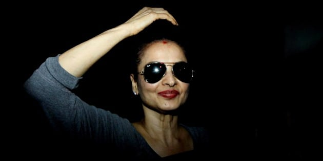 Indian Bollywood actress Rekha looks on as she leaves after taking part in production for the forthcoming Hindi film 'Super Nani' directed by Indra Kumar in Mumbai on late October 15 2014. AFP PHOTO/STR        (Photo credit should read STRDEL/AFP/Getty Images)