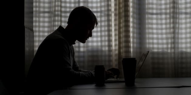 The silhouette of Ryan Hoover, founder and chief executive officer at Product Hunt, is see as he works on a computer at the company's office in San Francisco, California, U.S., on Wednesday, Feb. 4, 2015. Hoover, who at 28 bears a passing resemblance to a pre-bad boy Justin Bieber, is one of the most visible benefactors of the easy money fueling the tech boom, an earnest, hustling, unconventional power broker in San Francisco's let's-create-a-company culture. Photographer: David Paul Morris/Bloomberg via Getty Images