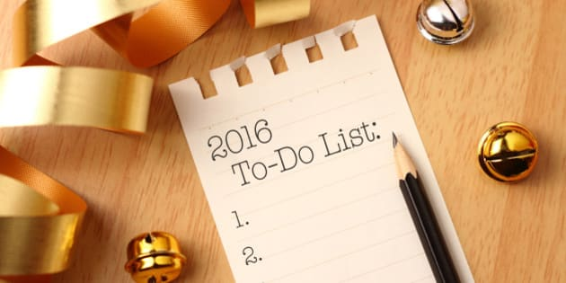 New Year's to-do list with gold color decorations. New Year's goals are resolutions or promises that people make for the New Year to make their upcoming year better in some way.