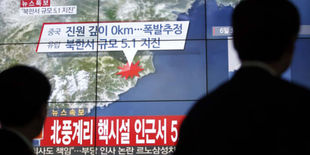 """People walk by a screen showing the news reporting about an earthquake near North Korea's nuclear facility, in Seoul, South Korea, Wednesday, Jan. 6, 2016. South Korean officials detected an """"artificial earthquake"""" near North Korea's main nuclear test site Wednesday, a strong indication that nuclear-armed Pyongyang had conducted its fourth atomic test. North Korea said it planned an """"important announcement"""" later Wednesday. The letter read """"5.1 Earthquake near North Korea's nuclear facility."""" (AP Photo/Lee Jin-man)"""