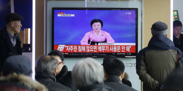 """People watch a TV news program showing North Korea's announcement, at the Seoul Railway Station in Seoul, South Korea, Wednesday, Jan. 6, 2016. North Korea said Wednesday it had conducted a hydrogen bomb test, a defiant and surprising move that, if confirmed, would put Pyongyang a big step closer toward improving its still-limited nuclear arsenal. The letters read """" Will not use nuclear weapon if autonomy secured.""""  (AP Photo/Ahn Young-joon)"""
